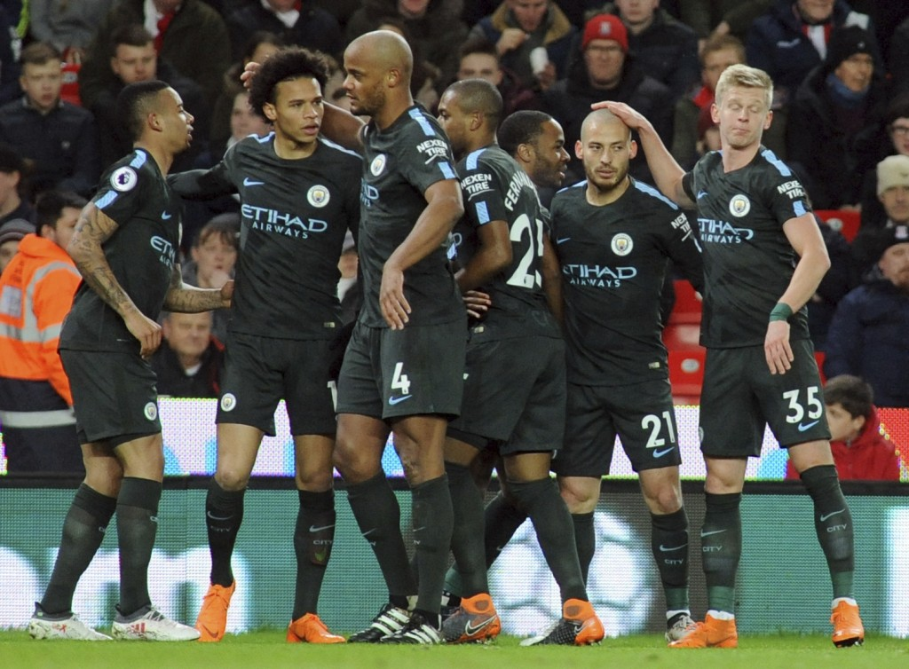 Manchester City's David Silva, second right, celebrates with teammates after scoring his side's first goal during the English Premier League soccer ma