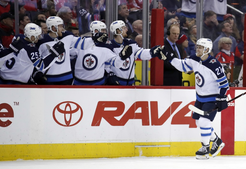 Winnipeg Jets left wing Nikolaj Ehlers (27), from Denmark, celebrates his goal with his teammates in the first period of an NHL hockey game against th