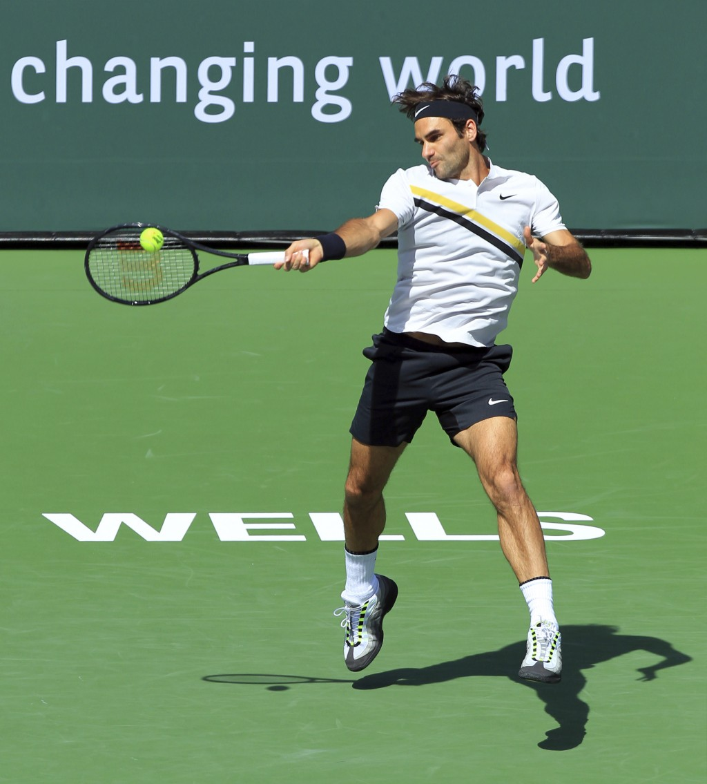 Roger Federer returns a shot to Filip Krajinovic during the third round of the BNP Paribas Open tennis tournament at the Indian Wells Tennis Garden in