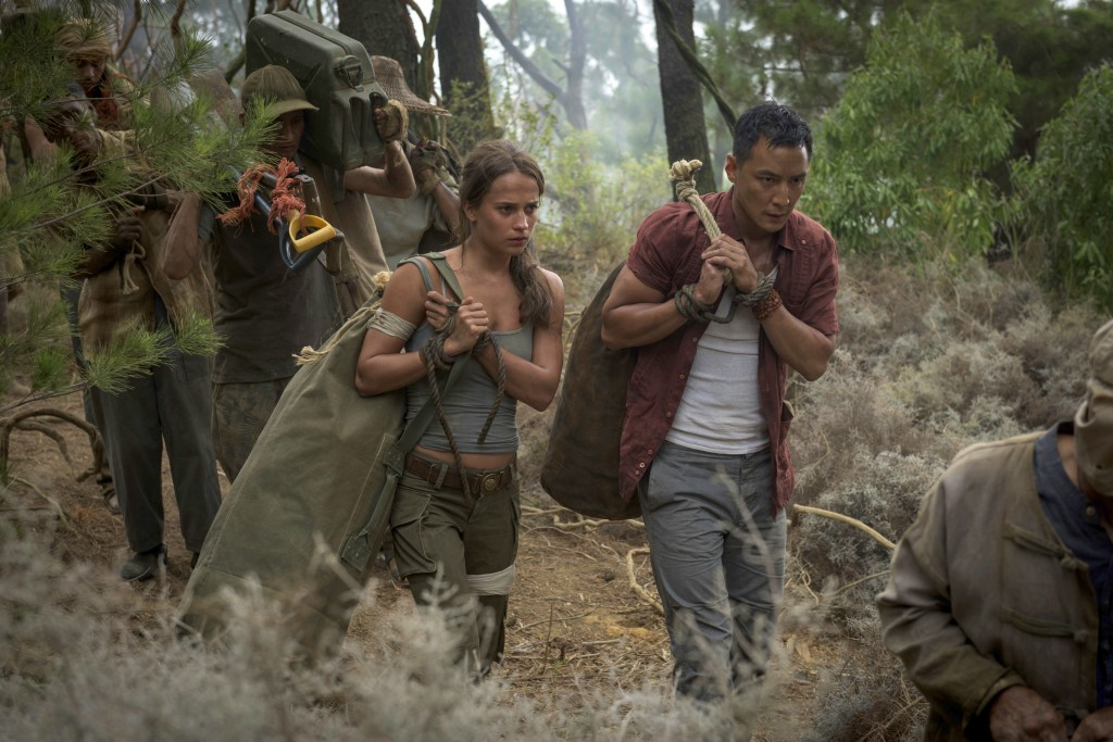 """This image released by Warner Bros. Pictures shows Alicia Vikander, left, and Daniel Wu in a scene from """"Tomb Raider."""" (Graham Bartholomew/Warner Bros"""