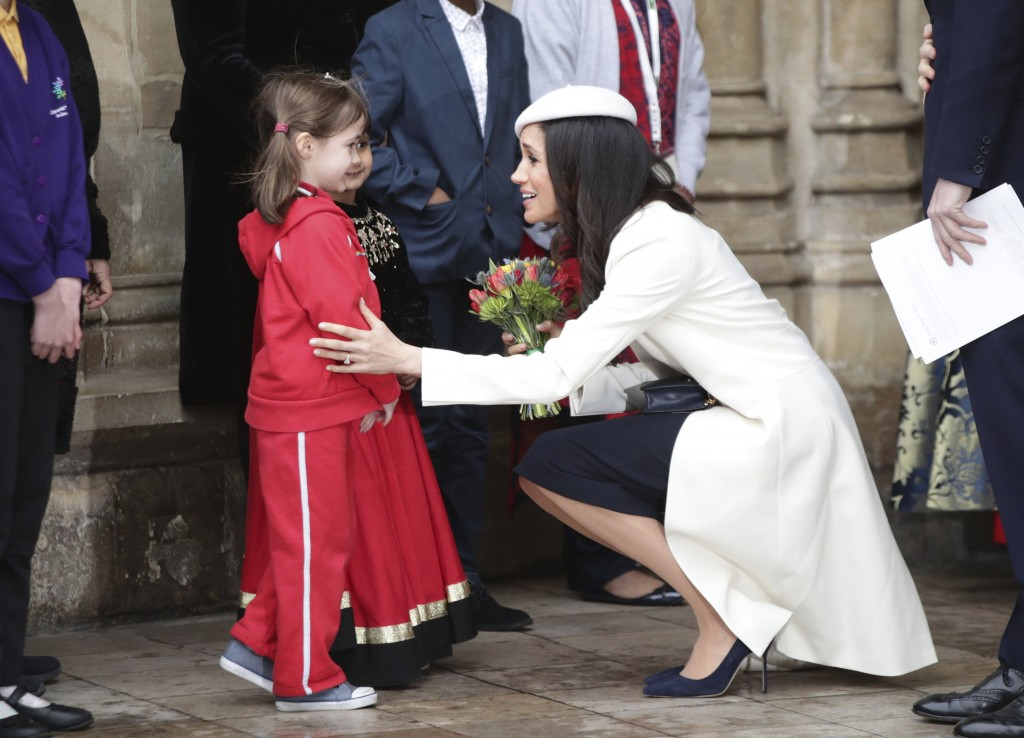 Meghan Markle talking to children as she leaves the Commonwealth Service at Westminster Abbey in London, Monday March 12, 2018. Organised by The Royal