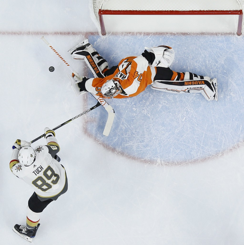 Philadelphia Flyers' Petr Mrazek (34) blocks a shot by Vegas Golden Knights' Alex Tuch (89) during the first period of an NHL hockey game, Monday, Mar