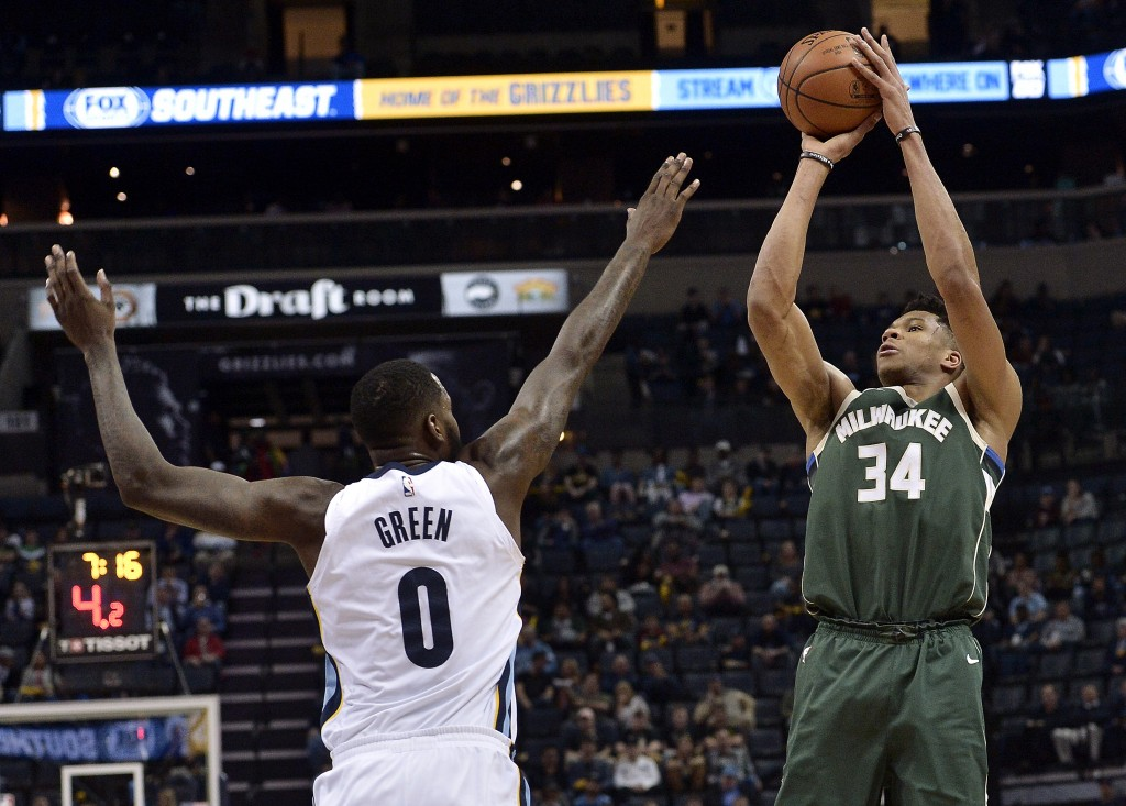 Milwaukee Bucks forward Giannis Antetokounmpo (34) shoots against Memphis Grizzlies forward JaMychal Green (0) in the first half of an NBA basketball
