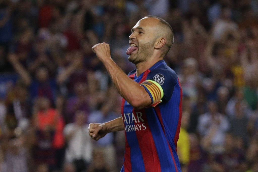 FILE - In this Sept. 13, 2016 file photo, Barcelona's Andres Iniesta celebrates scoring during a Champions League soccer match against Celtic, at the