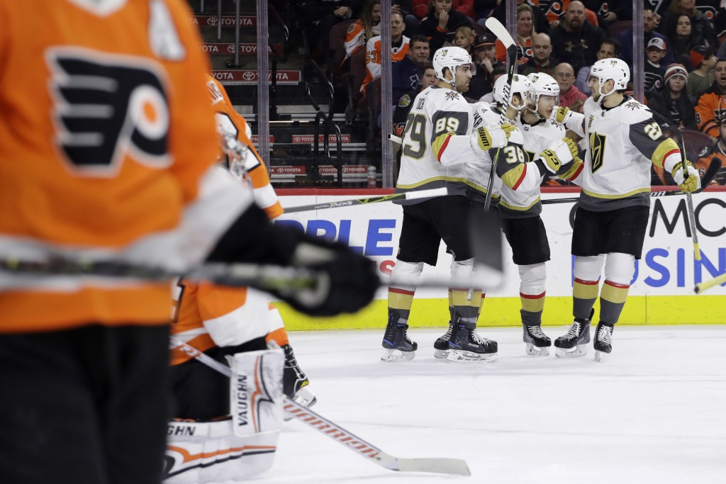 Vegas Golden Knights' Shea Theodore (27), William Karlsson (71), Tomas Hyka (38) and Alex Tuch (89) celebrate after a goal by Karlsson during the thir
