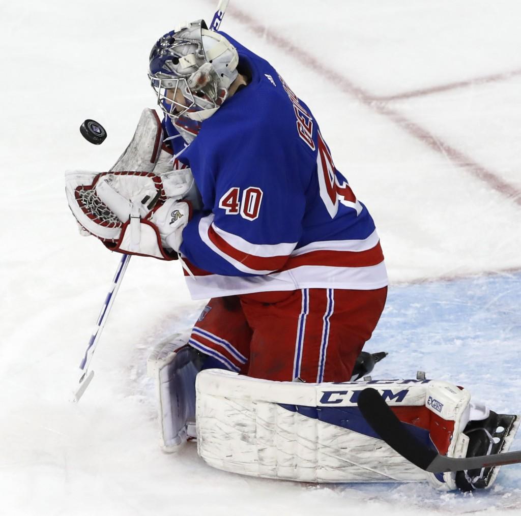 New York Rangers goaltender Alexandar Georgiev (40), of Bulgaria, makes a save during the second period of an NHL hockey game against the Carolina Hur