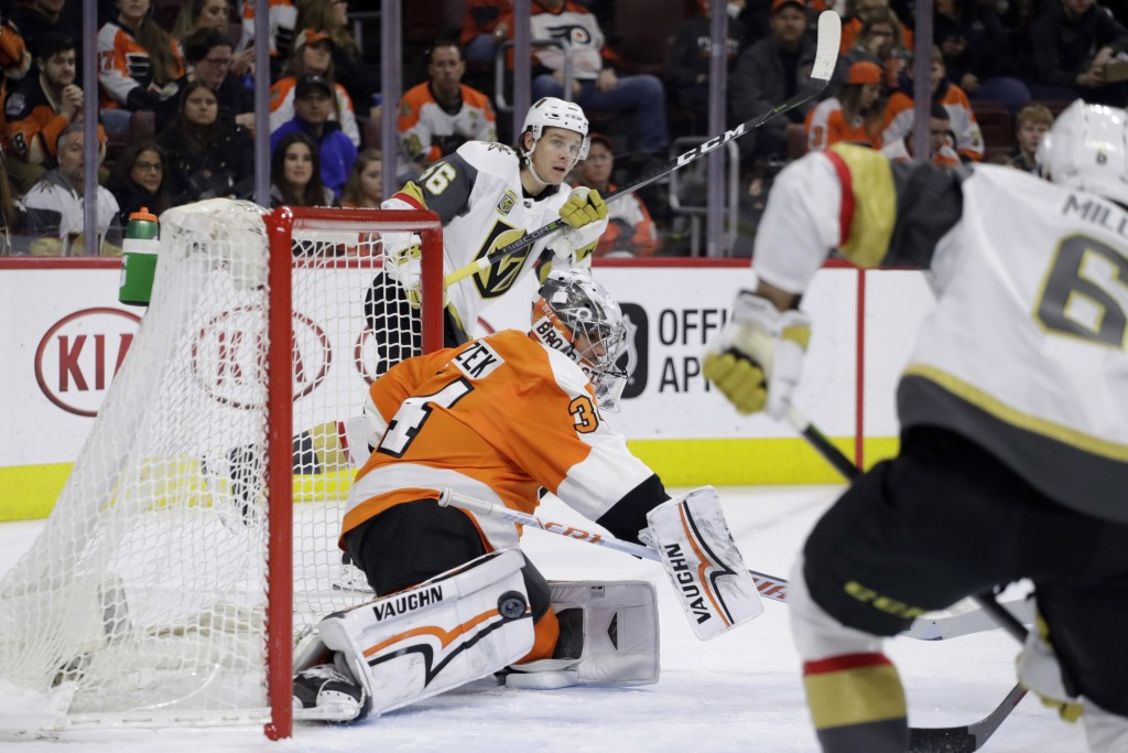 Philadelphia Flyers' Petr Mrazek, center, cannot block a goal by Vegas Golden Knights' Erik Haula, left, as Colin Miller looks on during the first per