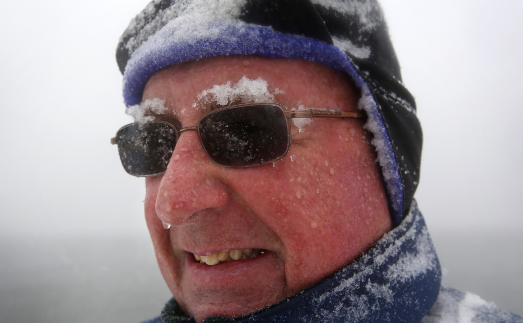 "Snow accumulates on Paul Knight's eyebrows as he walks during a nor'easter, Tuesday, March, 13, 2018, in Portland, Maine. ""It's typical March weather,"