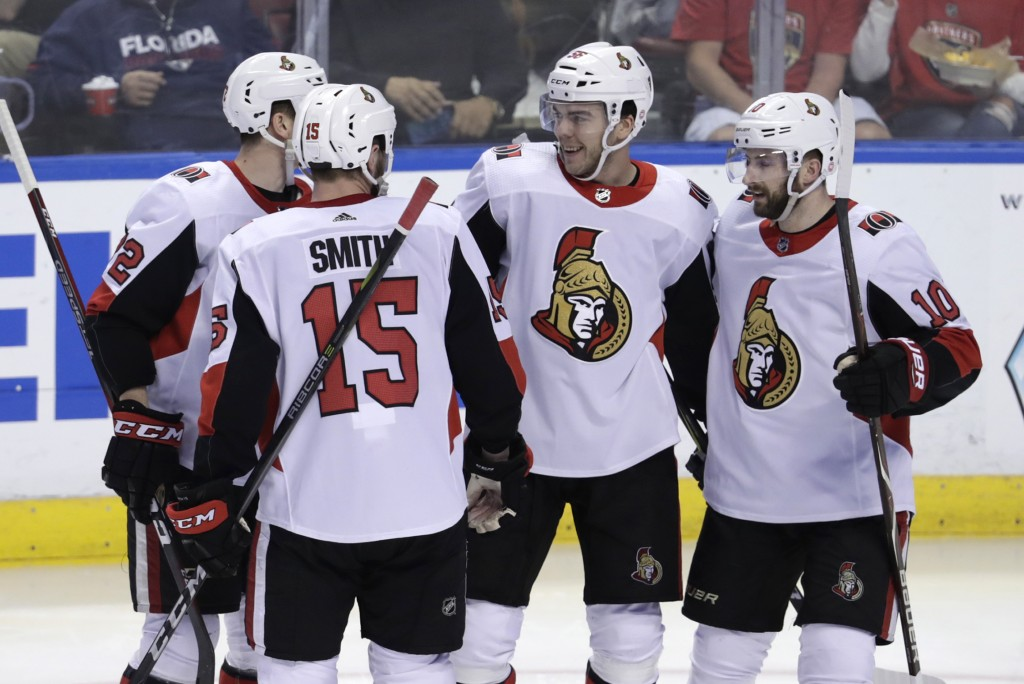 Ottawa Senators' Magnus Paajarvi, second from right, celebrates his goal with Zack Smith (15) and Tom Pyatt (10) during the third period of an NHL hoc