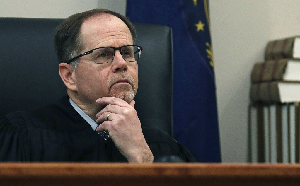 "FILE - In this Feb. 13, 2018, file photo, Judge Charles Temple listens to attorney Steven M. Gordon, who represents lottery winner ""Jane Doe"", during"