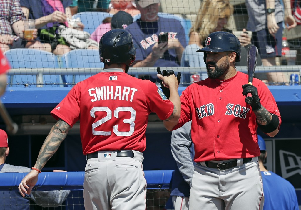 After hitting a home run in the fifth inning against the Toronto Blue Jays, Boston Red Sox's Blake Swihart (23) gets a fist-bump from teammate Sandy L