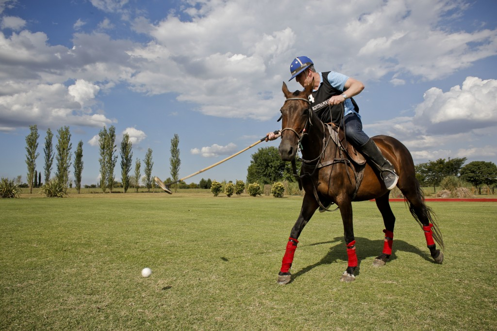 In this Feb. 27, 2018 photo, Jed Hulsey, from Newport Beach, California, hits the ball during a polo practice at La Carona club, Capilla del Senor, Bu