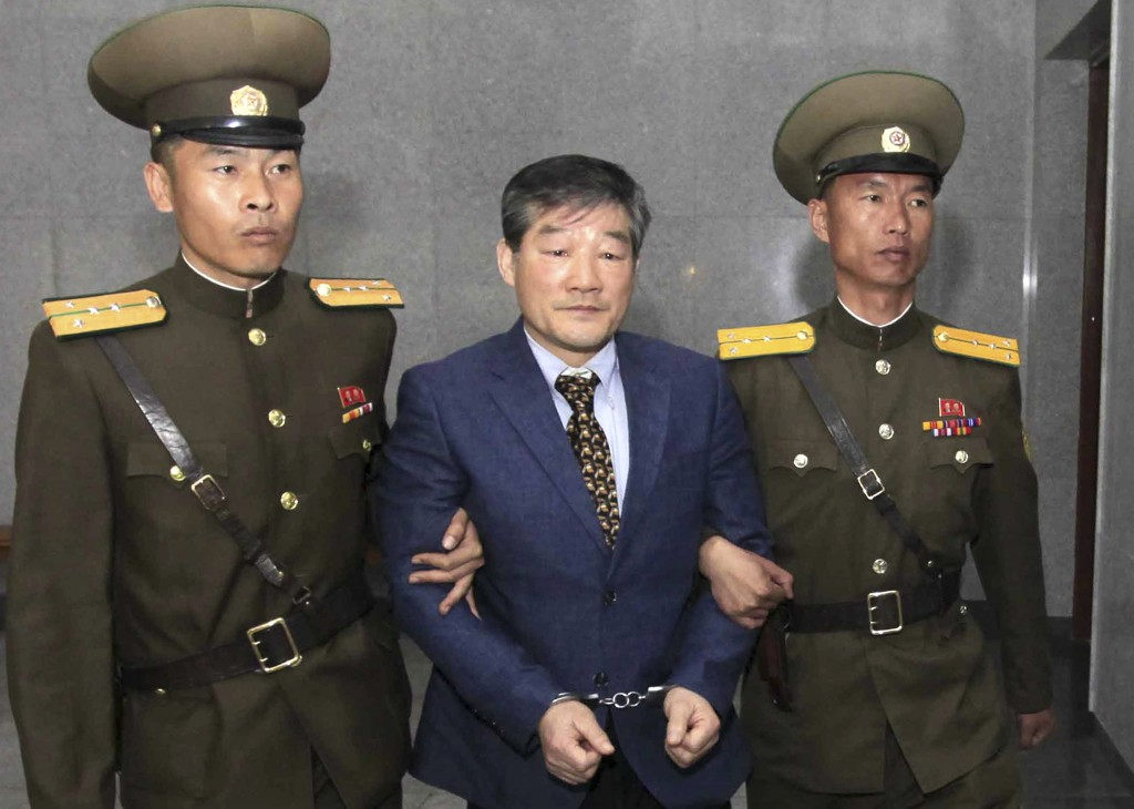 FILE - In this April 29, 2016, file photo, Kim Dong Chul, center, a U.S. citizen detained in North Korea, is escorted to his trialin Pyongyang, North