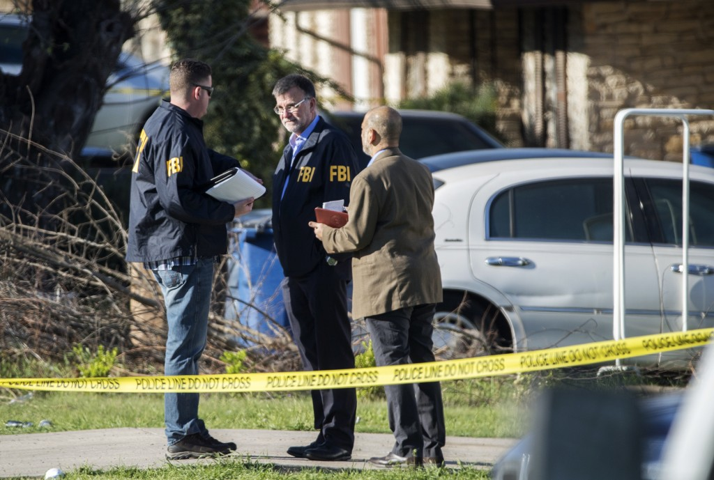Authorities investigate the scene after multiple explosions in Austin on Monday, March 12, 2018. Police are responding to another explosion Monday, th