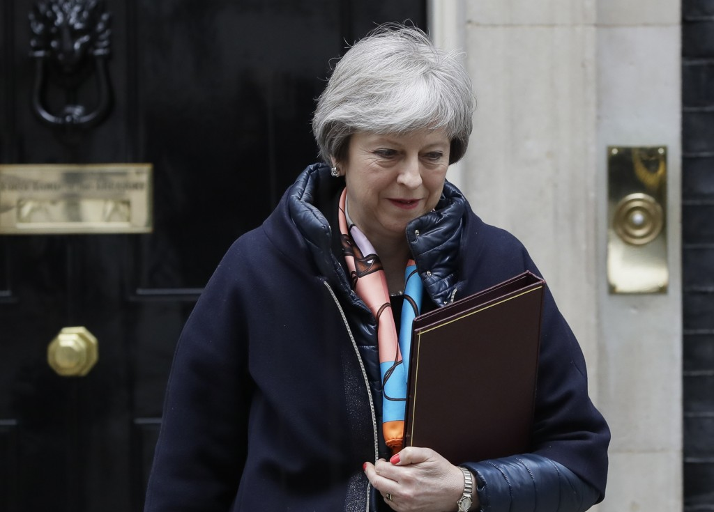 Britain's Prime Minister Theresa May leaves Downing Street to attend parliament for the Chancellors Spring Statement, in London, Tuesday, March 13, 20