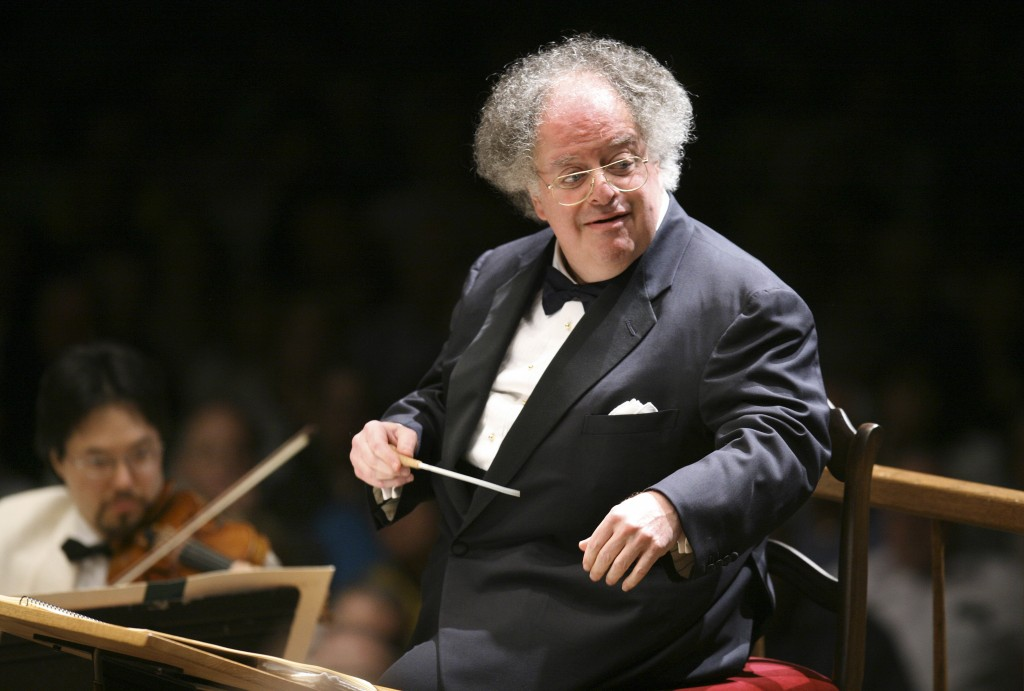 FILE - In this July 7, 2006 file photo, Boston Symphony Orchestra music director James Levine conducts the symphony on its opening night performance a