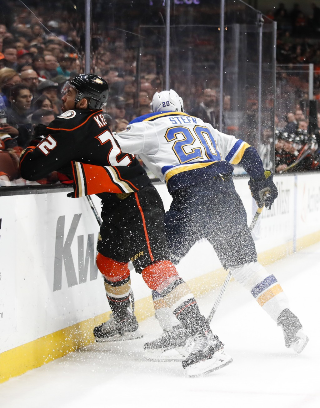 Anaheim Ducks' Chris Kelly, left, is checked by St. Louis Blues' Alexander Steen during the second period of an NHL hockey game, Monday, March 12, 201