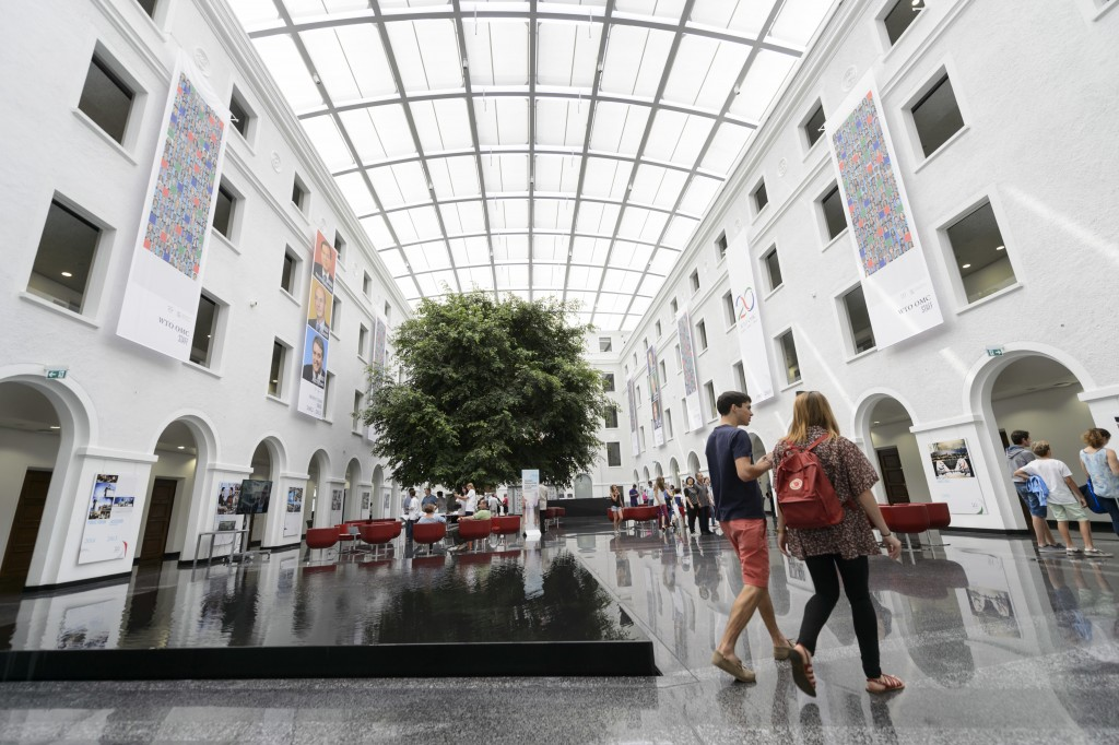 "FILE - In this Sunday, June 14, 2015 file photo, people visit the WTO headquarters during the open day at the WTO: ""Merci Geneve"" at the World Trade O"