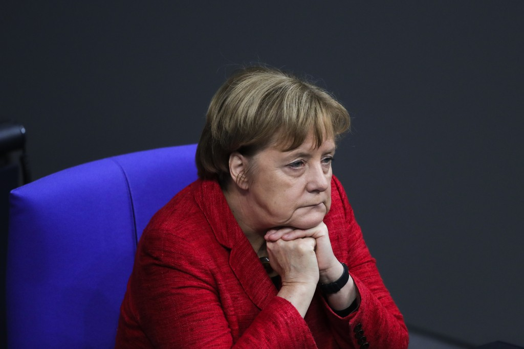 FILE - In this Nov. 21, 2017 file photo German Chancellor Angela Merkel attends a plenary session of German parliament Bundestag in Berlin. On Wednesd