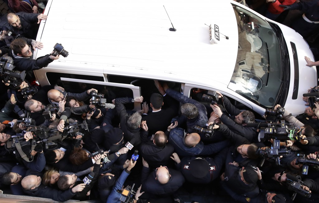 Five-Star Movement's leader Luigi Di Maio, center, back to the camera boards a taxi as he leaves the foreign press association headquarters in Rome, T