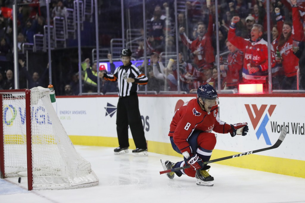 Washington Capitals left wing Alex Ovechkin (8) celebrates his goal in the second period of an NHL hockey game against the Winnipeg Jets, Monday, Marc