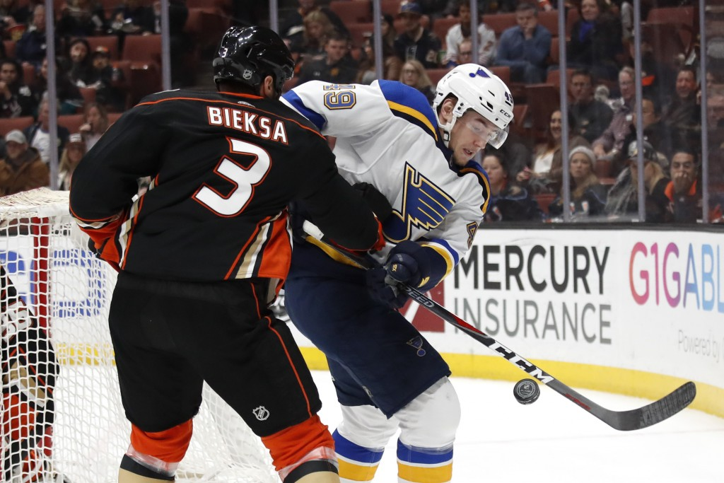 St. Louis Blues' Ivan Barbashev, right, of Russia, is defended by Anaheim Ducks' Kevin Bieksa during the first period of an NHL hockey game Monday, Ma