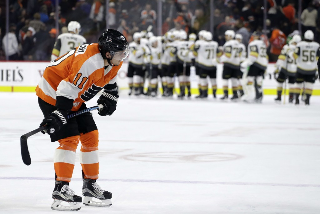 Philadelphia Flyers' Travis Konecny (11) skates back to the bench after losing an NHL hockey game against the Vegas Golden Knights, Monday, March 12,