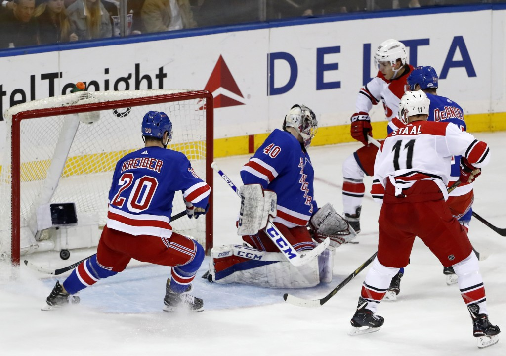 New York Rangers left wing Chris Kreider (20) watches as Carolina Hurricanes left wing Teuvo Teravainen, upper right, of Finland, scores while Rangers