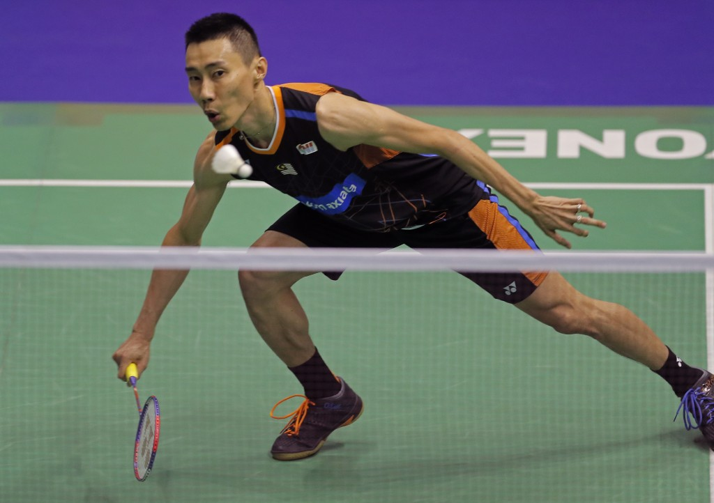 FILE -A Sunday, Nov. 26, 2017 file photo of Lee Chong Wei of Malaysia returning a shot to Chen Long of China in the final of the men's singles during