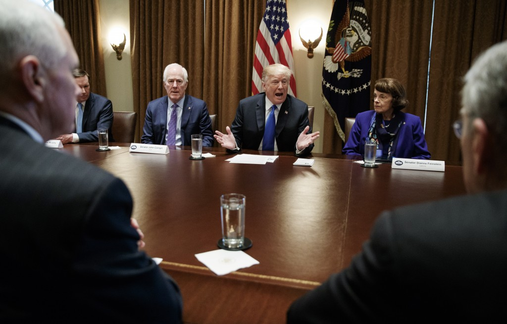 FILE - In this Feb. 28, 2018, file photo, President Donald Trump speaks in the Cabinet Room of the White House, in Washington, during a meeting with m