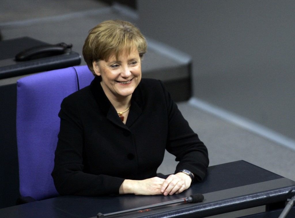 FILE - In this Tuesday, Nov. 22, 2005 file photo new German Chancellor Angela Merkel sits on the chancellor's seat for the first time in the parliamen