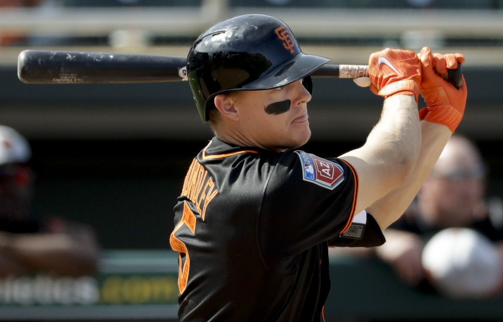 San Francisco Giants' Nick Hundley watches his three-RBI double against the Oakland Athletics during the fifth inning of a spring baseball game in Mes