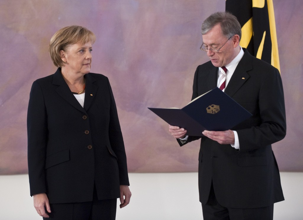FILE - In this Oct. 28, 2009 file photo German Chancellor Angela Merkel, left, receives her letter of appointment from German President Horst Koehler,