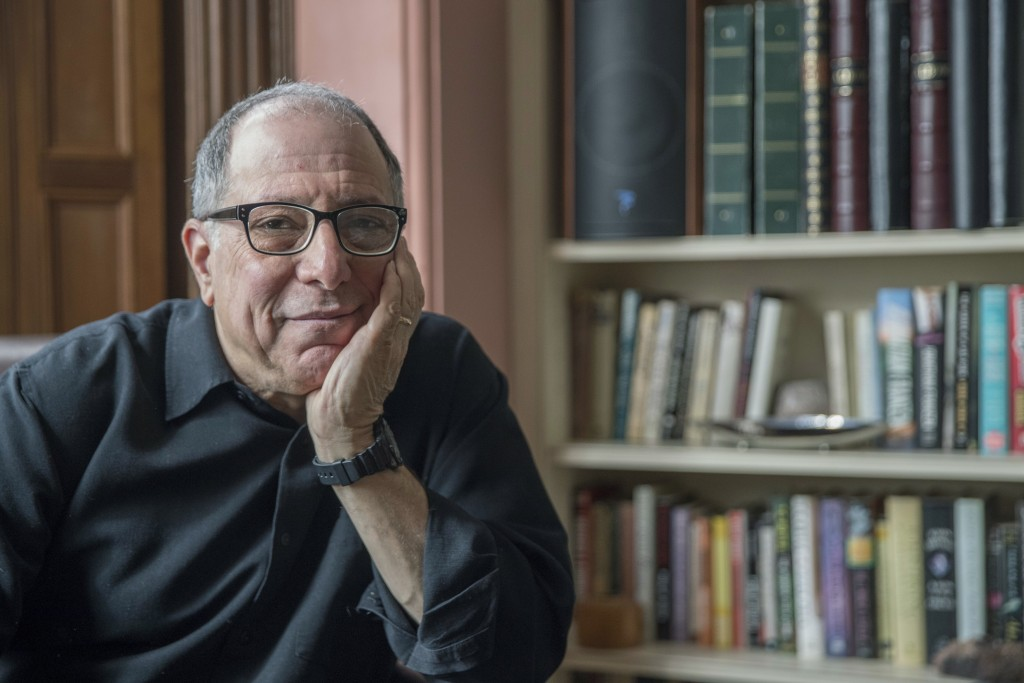 """In this Saturday, March 10, 2018 photo, Michael Kimmel poses at his home in New York. Kimmel is a leader in what's known as """"masculinities studies,"""" a"""