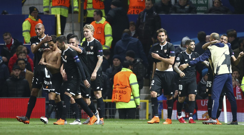 Sevilla's Wissam Ben Yedder, second left puts his shirt back on as he celebrates with teammates after scoring his sides second goal during the Champio
