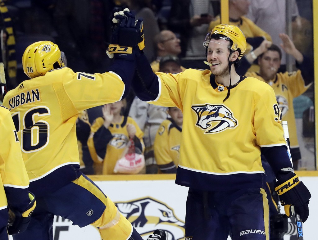 Nashville Predators' P.K. Subban (76) and Ryan Johansen (92) celebrate after beating the Winnipeg Jets in an NHL hockey game Tuesday, March 13, 2018,