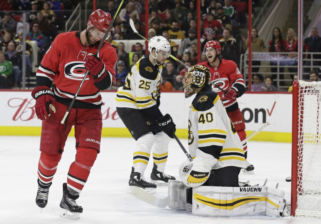Boston Bruins goalie Tuukka Rask (40), of Finland, gives up a goal by Carolina Hurricanes' Teuvo Teravainen, not shown, as Hurricanes' Jordan Staal (1