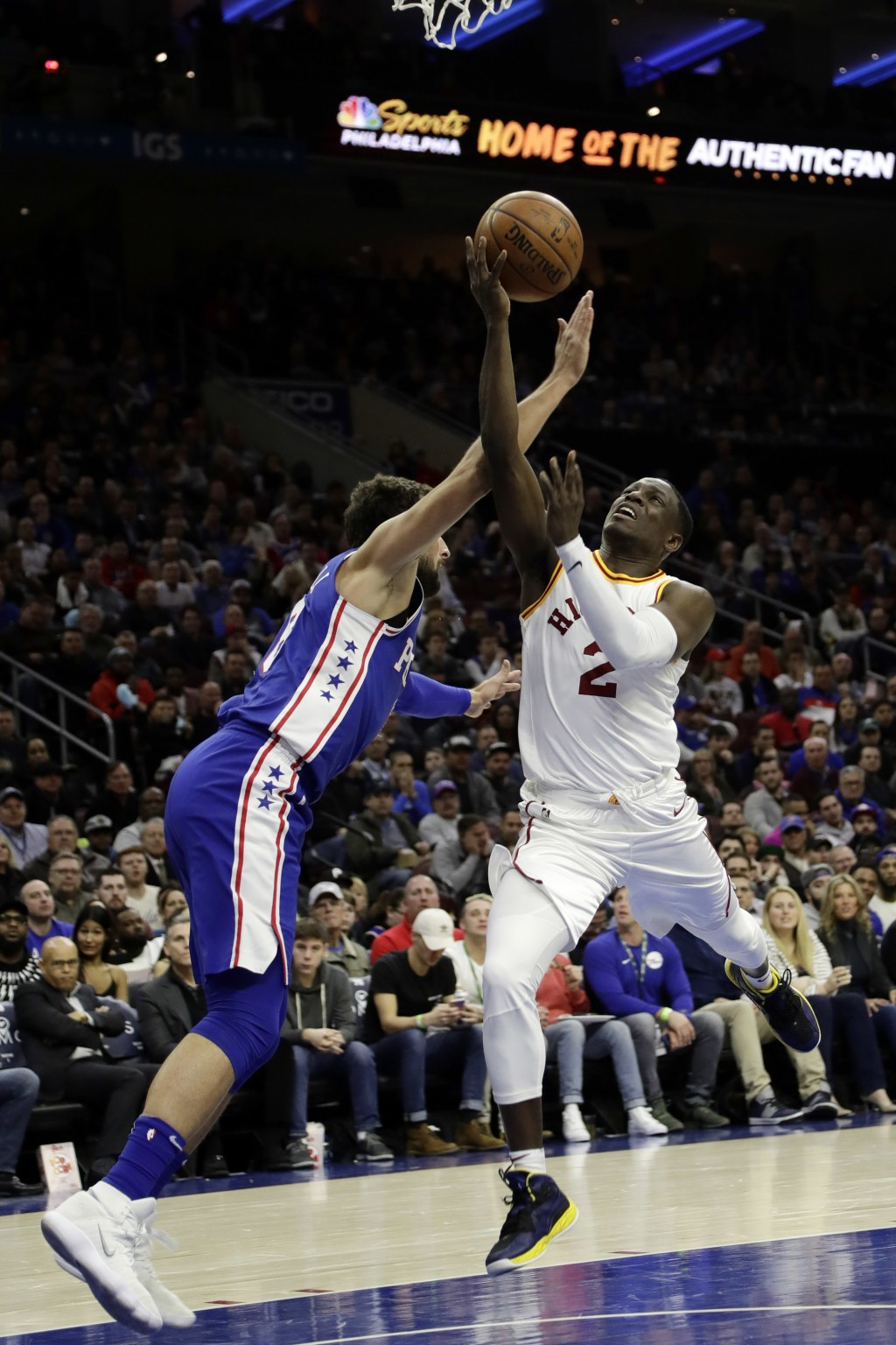 Indiana Pacers' Darren Collison, right, goes up for a shot against Philadelphia 76ers' Marco Belinelli during the first half of an NBA basketball game
