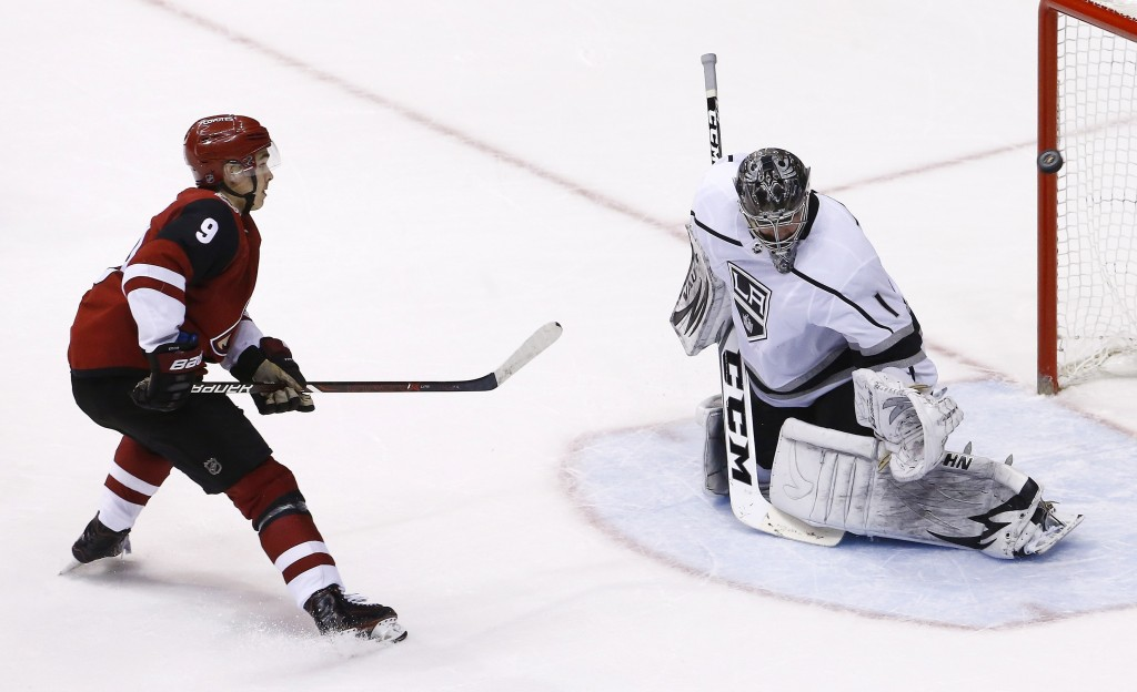 Arizona Coyotes center Clayton Keller (9) scores against Los Angeles Kings goaltender Jack Campbell (1) during a shootout of an NHL hockey game Tuesda