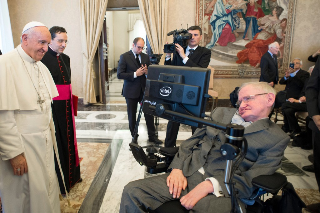 FILE - In this Monday, Nov. 28, 2016 file photo Pope Francis greets physicist Stephen Hawking during an audience with participants at a plenary sessio