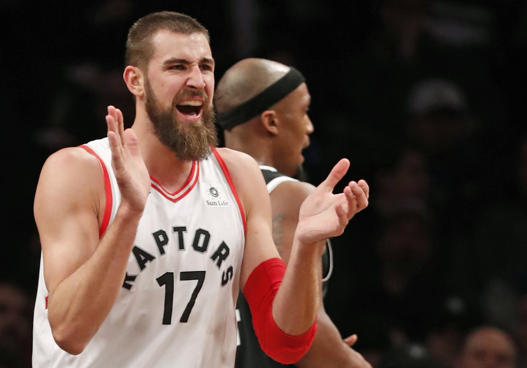 Toronto Raptors center Jonas Valanciunas (17) reacts toward the Raptors' bench after earning a free-throw during the second half of an NBA basketball