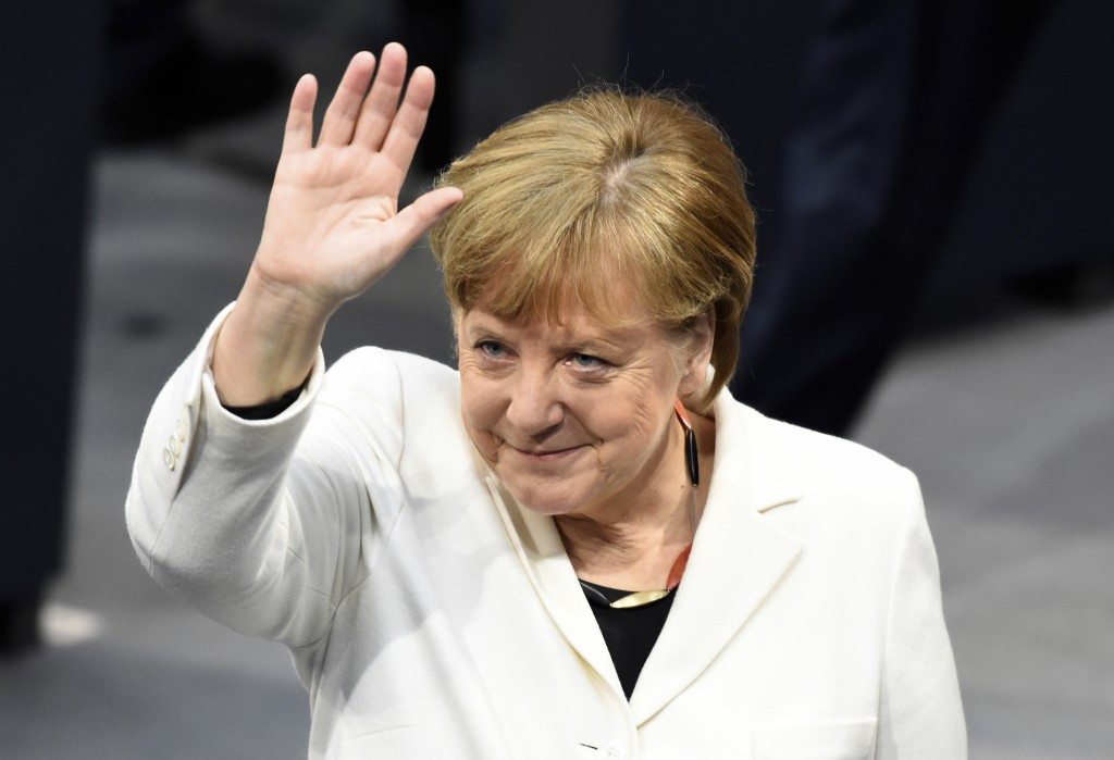 German Chancellor Angela Merkel waves when Germany's parliament Bundestag meets to elect Angela Merkel for a fourth term as chancellor in Berlin, Germ
