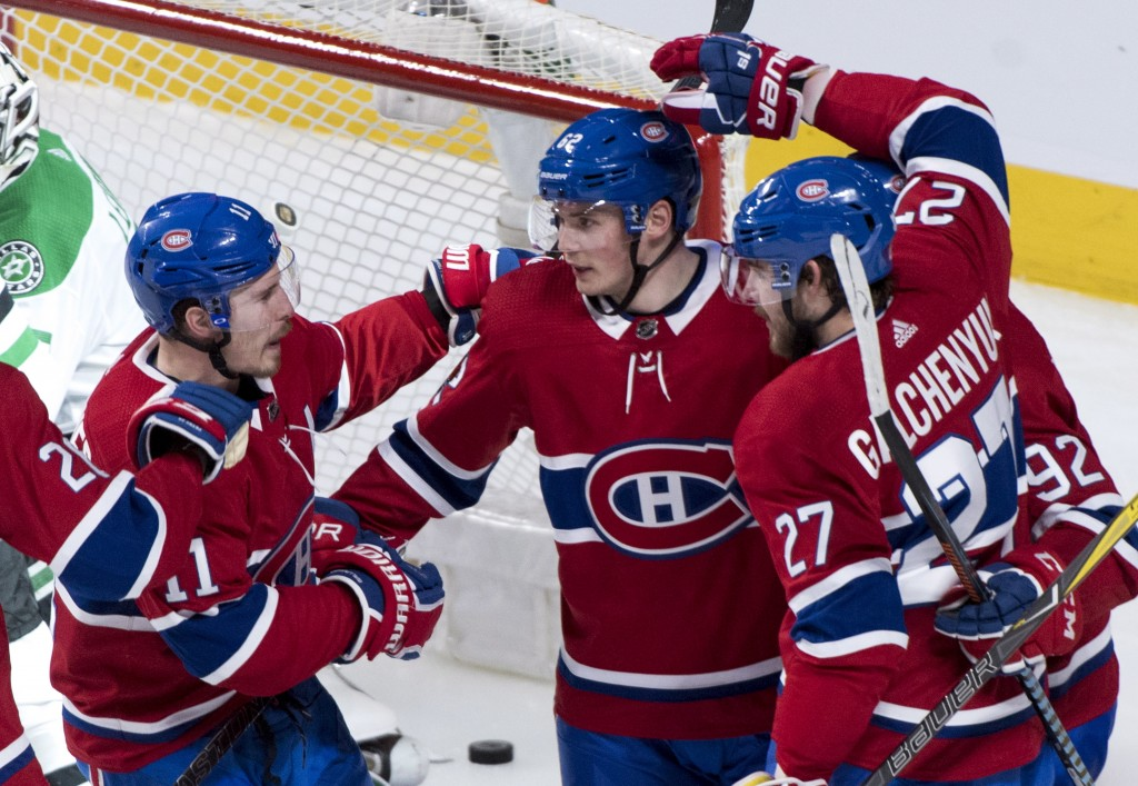 Montreal Canadiens left wing Artturi Lehkonen (62) is congratulated by teammates right wing Brendan Gallagher (11) and left wing Alex Galchenyuk (27)