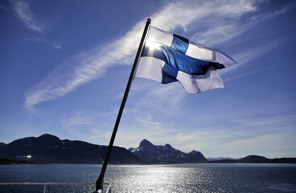 FILE - In this Saturday, July 29, 2017 file photo, Finland's flag flies aboard the Finnish icebreaker MSV Nordica as it arrives into Nuuk, Greenland.