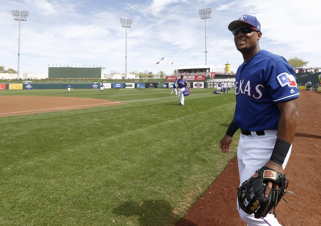 Texas Rangers third baseman Adrian Beltre smiles as he walk onto the field to warm up prior to the team's spring training baseball game against the Ch