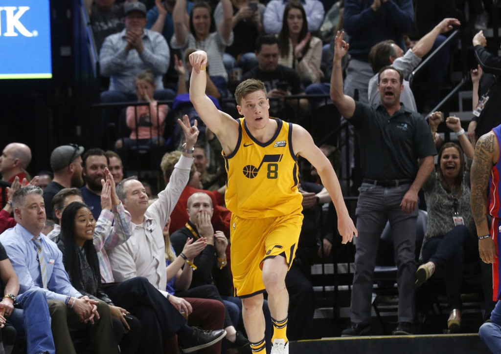 Utah Jazz's Jonas Jerebko (8) reacts after scoring a 3-point shot in the first half of an NBA basketball game against the Detroit Pistons on Tuesday,