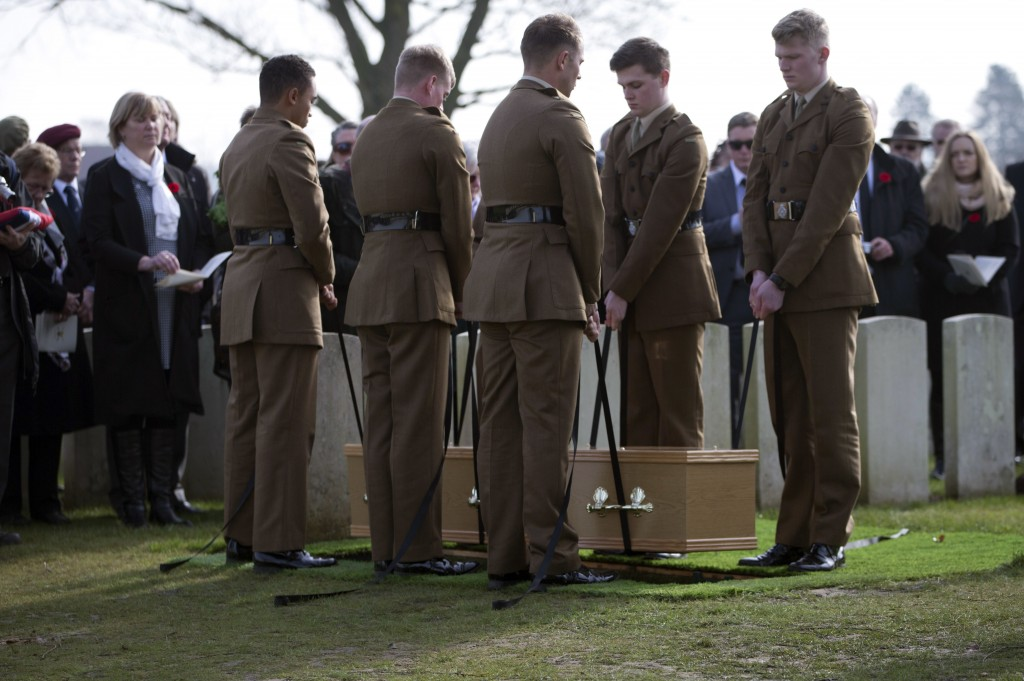 Soldiers lower the casket of British Private Thomas Edmundson during a re-burial service at CWGC Perth Cemetery in Ypres, Belgium, Wednesday, March 14