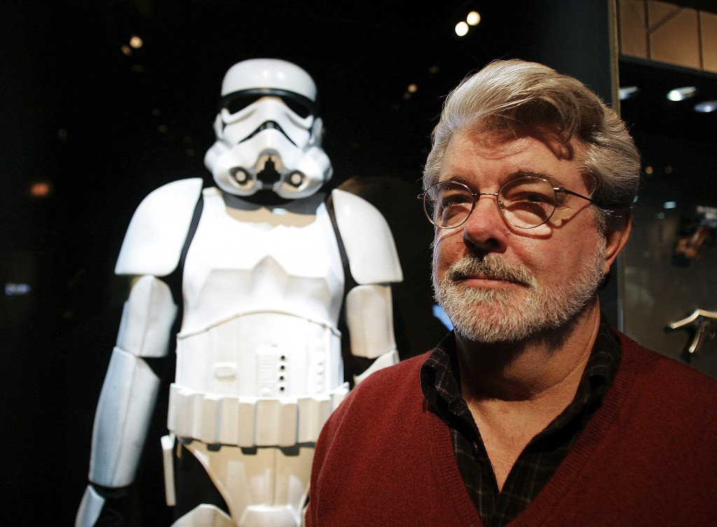 FILE - In this Oct. 22, 2005 file photo, filmmaker George Lucas poses in front of a Stormtrooper exhibit at the Museum of Science in Boston, prior to