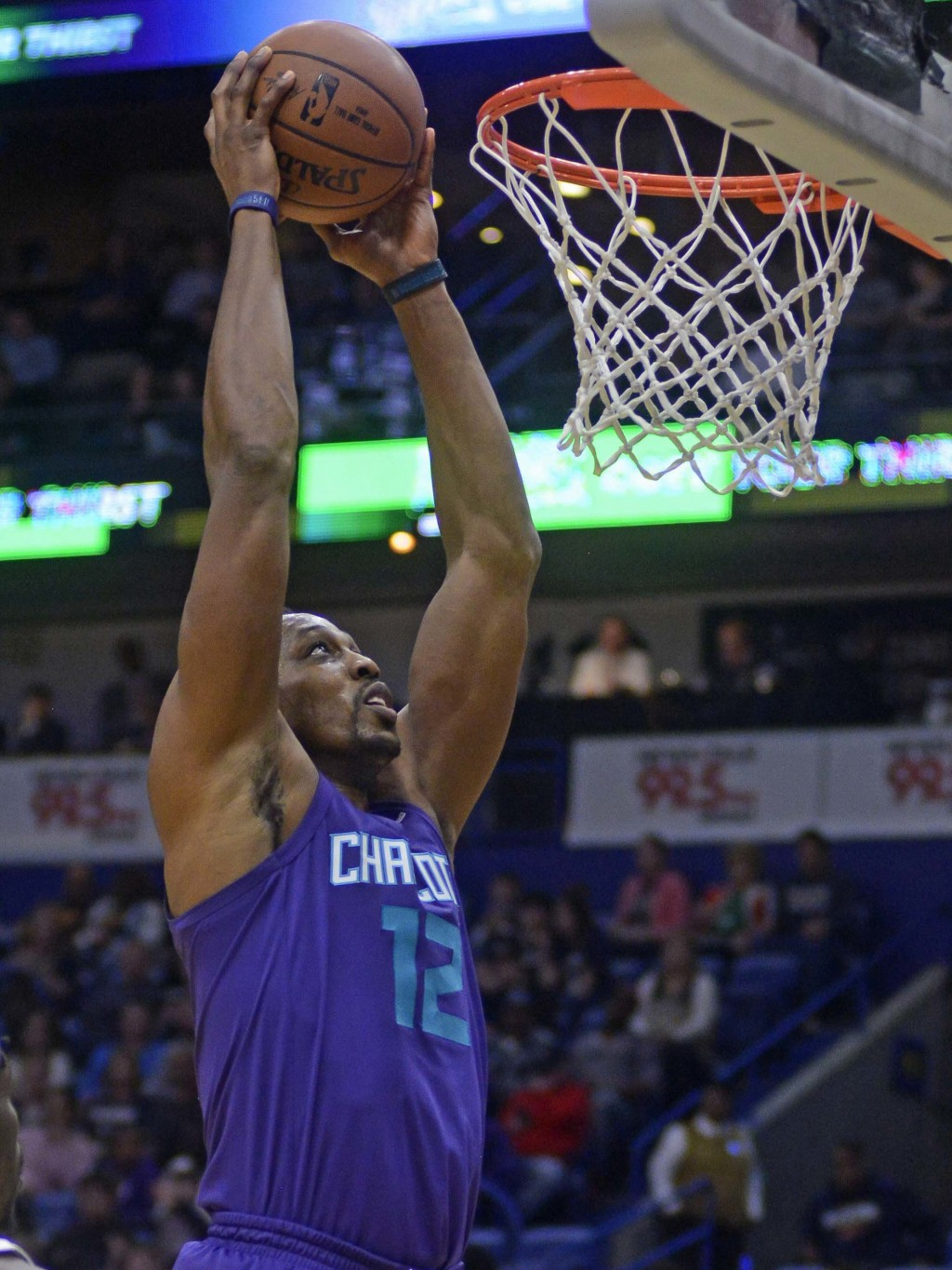 Charlotte Hornets' Dwight Howard (12) dunks the ball against the New Orleans Pelicans in the first half of an NBA basketball game in New Orleans, Tues