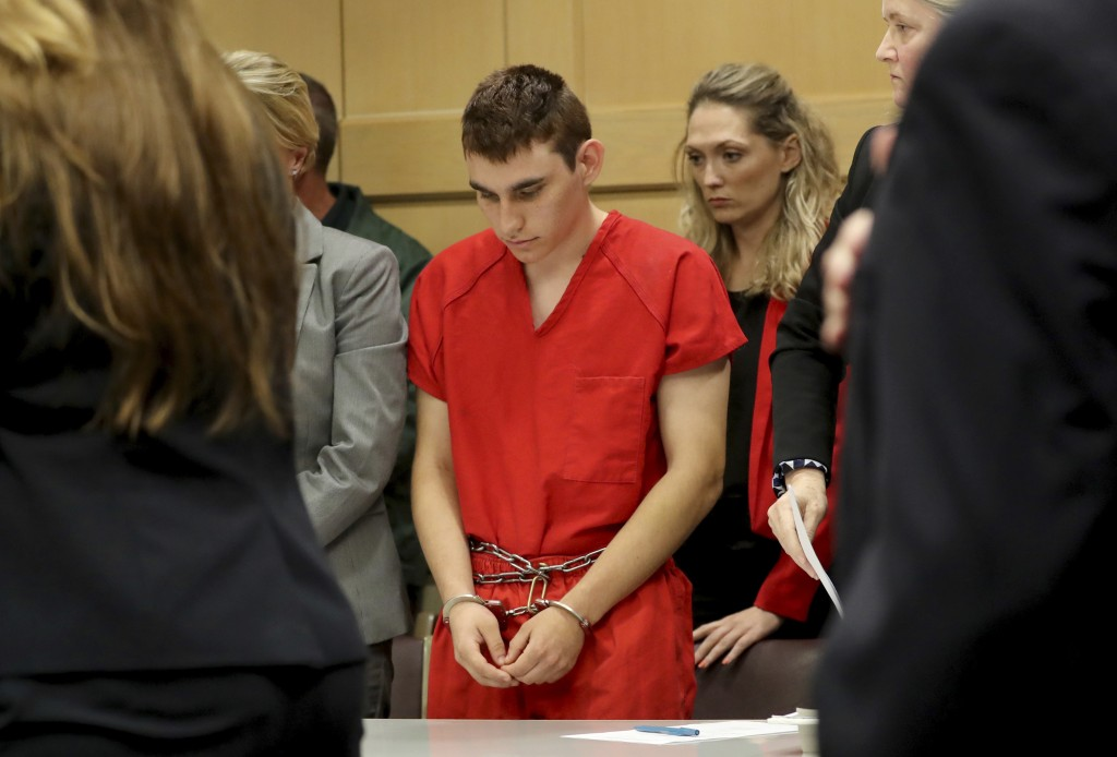 FILE- This Feb. 19, 2018 file photo shows Nikolas Cruz appearing in court for a status hearing before Broward Circuit Judge Elizabeth Scherer in Fort